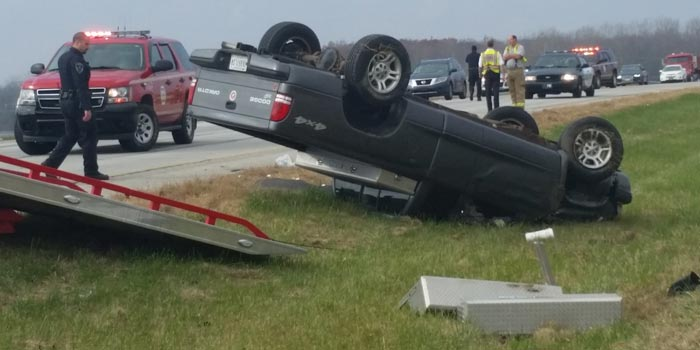 A pickup truck lies upside down in the median of Lake City Highway, near Detroit Street. (Photo by Amanda McFarland)