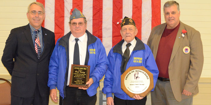 "John Sadler, left, and Ken Locke, right, presented two SAL awards. Fred Vining, second from left, received the meritorious award and Robert ""Bob"" Savage, received the Order of Kosciuszko Award. (Photo by Deb Patterson)"
