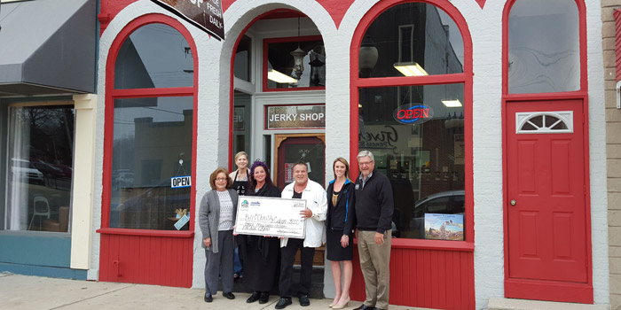 Shown at the grant presentation, from left, are Cindy Dobbins, City of Warsaw Councilwoman and  WCDC Board; Christy Cuban; Bill Cuban; Jen Pyle, Main Street Coordinator for the Kosciusko Chamber of Commerce, WCDC; and Mayor Joseph Thallemer, City of Warsaw, WCDC Board. In back is Lisa Bentele, Jerky Shop Owner. (Photo provided)