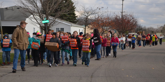 Harrison Elementary Schol students deliver food on foot to CCS.