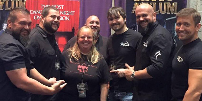 Tim and Kina Fuller, center, pose with members of Ghost Asylum, a television show on TWC. (Photo provided)