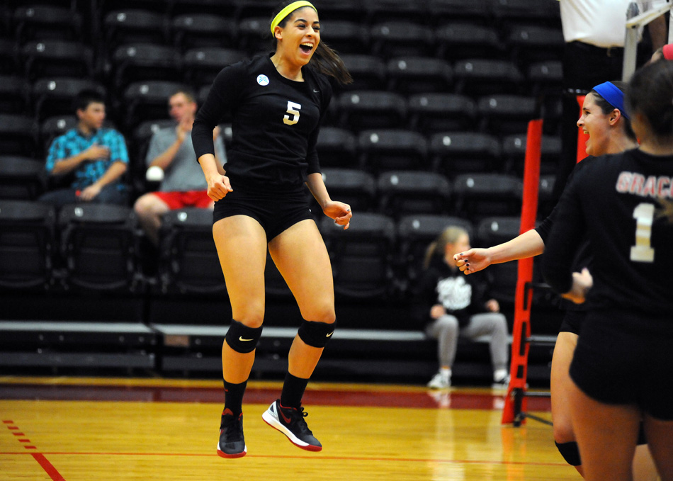 Annie Salazar of Grace reacts after a point in the first game of a 3-0 sweep of Bethel College in the first round of the Crossroads League volleyball tournament Saturday night at Grace. (Photos by Mike Deak)