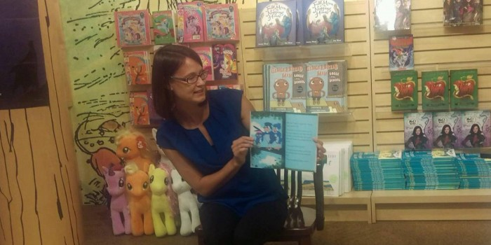 Joy Hill reads from her new book to some young fans.