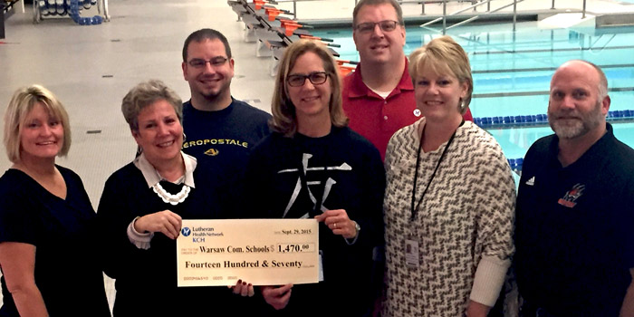 A check was presented by KCH and Lutheran EMS Kosciusko to Warsaw High School to purchase an AED. Shown in front are: WCHS Cordinator Chris Lalonde, CNO Kim Finch, WCHS School Nurse Jeanine DeGeeter, Edgewood Middle School Nurse Tracey Akers, WCHS Athletic Director Dave Anson. Standing in back are WCHS Pool Manager Mike McCammom, and Lutheran EMS Director of Operations Tony Doyle.