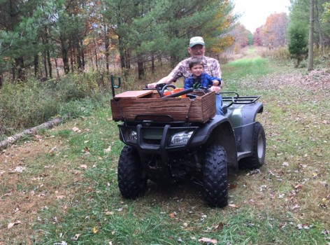 Bill Claxton and his great grandson Ian share a four-wheel ride through Claxton Woods, the property Bill has gifted to ACRES Land Trust for permanent protection.