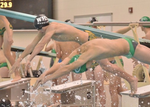 Brady Robinson (left) begins his 200 IM in Tuesday's meet at Concord. (Photos by Nick Goralczyk)
