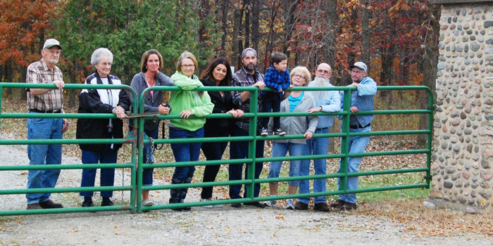 The Claxton family standing at the gate. Shown from left, are: Bill and Shirley Claxton, Laura (Claxton ) Troyer, Martha (Claxton) Coffing, Jaime, Chris and Ian Claxton, Joy and Jim Claxton and James Claxton. (Photo provided)