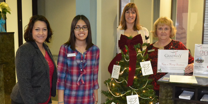 Old National Bank staff pose with Gradway Giving Tree.