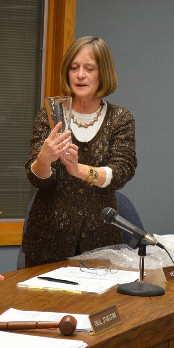 Syracuse Clerk Treasurer Julie Kline reads the inscription on a glass vase she received from the Syracuse Town Council as a thank you gift for her years of service during the Syracuse Town Council meeting Tuesday, Dec. 15. Kline is retiring at the end of the year.