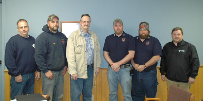 Tim Miller of Milford, third from left, suffered a heart attack just before 8 a.m. Oct. 26, but thanks to the efforts of emergency medical personnel he was successfully resuscitated. Scott Sigurfoos and Millie Bartley of Lutheran EMS Kosciusko were at Milford's Town Council meeting to recognize, from left, Rodney Bray, Scott Mast, Chad Veach, Corey Veach of the Milford Fire Department and paramedic Steve Stokes of Lutheran EMS. Others not present were, from Milford Fire Department Rob Brooks, Steve Farber, Troy Haines, Dan Duncan, Kevin Walker, Virgil Sharp and Brian Haines, paramedics Hannah Young, Darrell Sopher and advanced EMT Kim Miller. (Photo by David Hazledine)