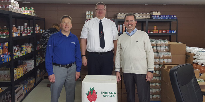 Apples were delivered to the Salvation Army, along with other local organizations by the Kiwanis Club of Warsaw. Shown, from left, are Adam Clemens, Kiwanis President; Bill Welch Jr., Salvation Army; and Michael Suhany, Kiwanis President Elect. (Photo provided)