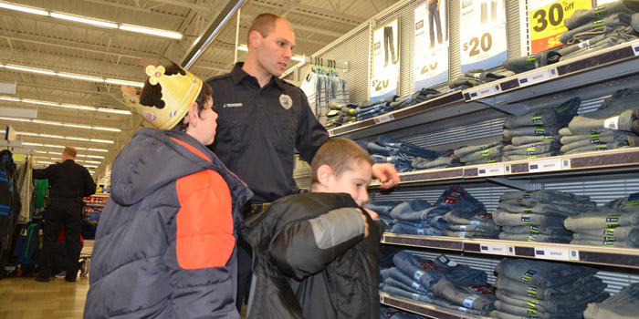 Jeff Ticknor helps Beau and Kadin Ward pick out new jeans.