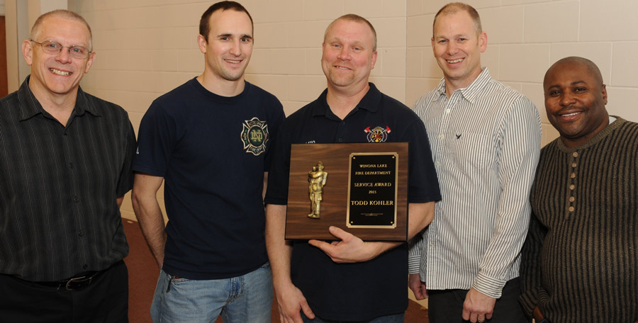 Winona Lake Firefighter Todd Kohler was presented the department's service award. From left, are, Mike Raymer, Matt Stamm, Kohler, Carson Kintzel and J.W. Anderson. (Photo by Al Disbro)