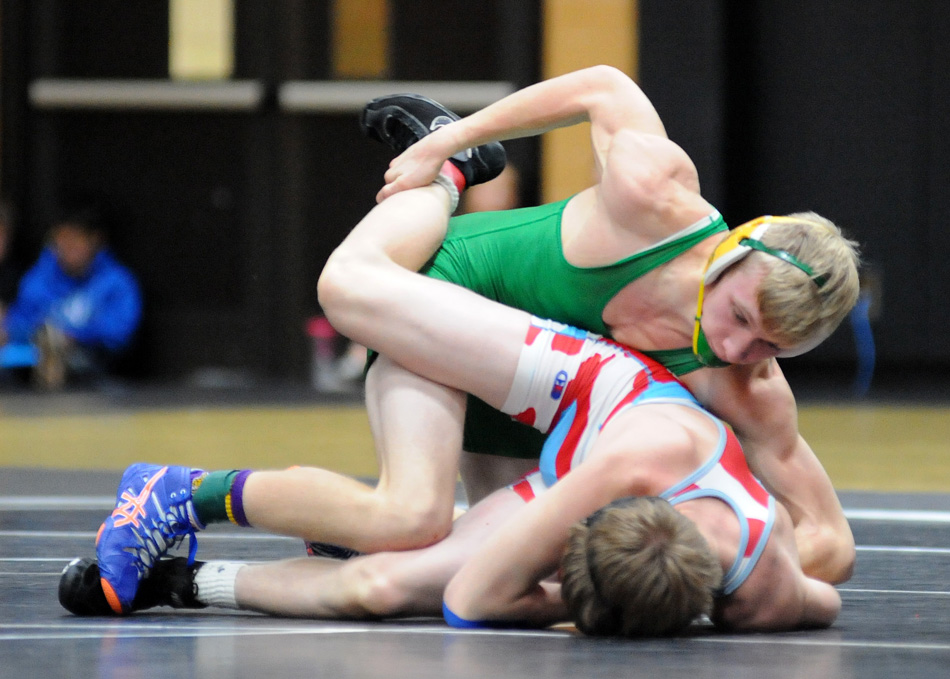 Chevy Teeter of Tippecanoe Valley controls Zach Purcell of Maconaquah in the 132-pound bracket.
