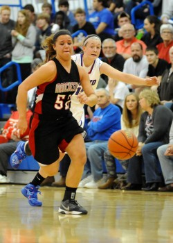 Manchester's Cierra Carter chases after a loose ball with Whitko's Aly Reiff in pursuit.