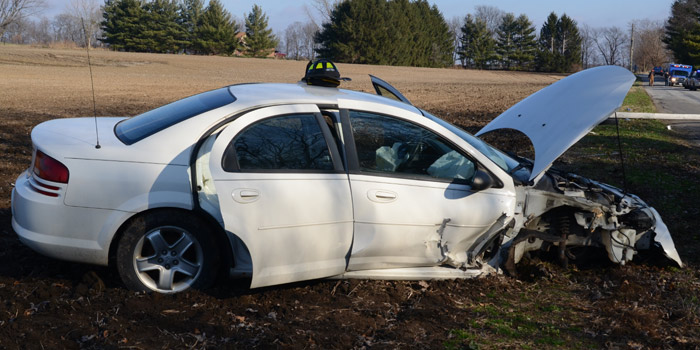 Extensive damage to the Dodge Stratus.