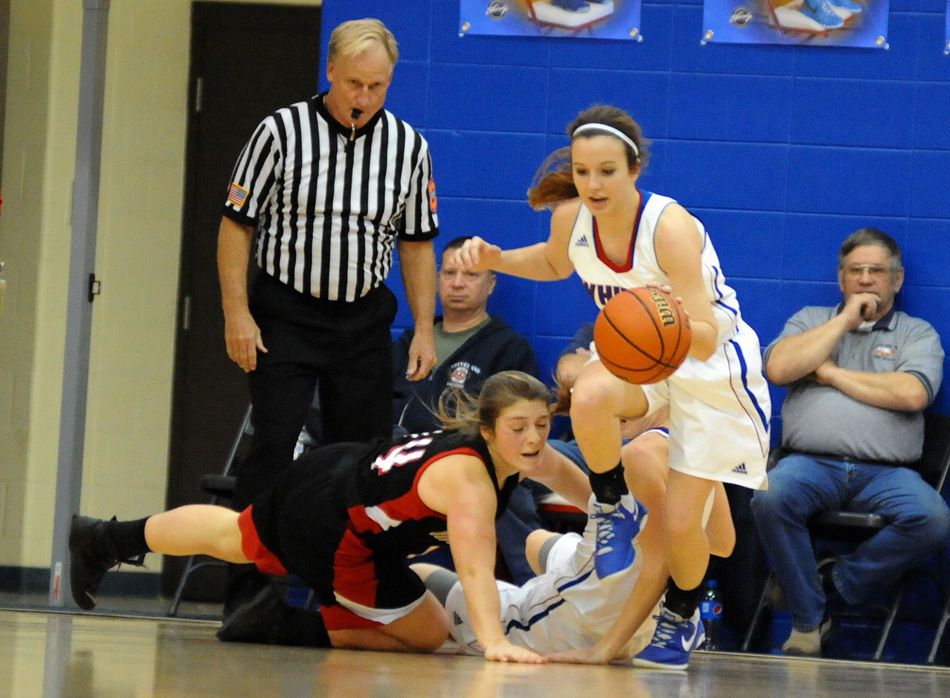 Hanna Yohe creates one of 27 turnovers Whitko coaxed out of Manchester Friday night.
