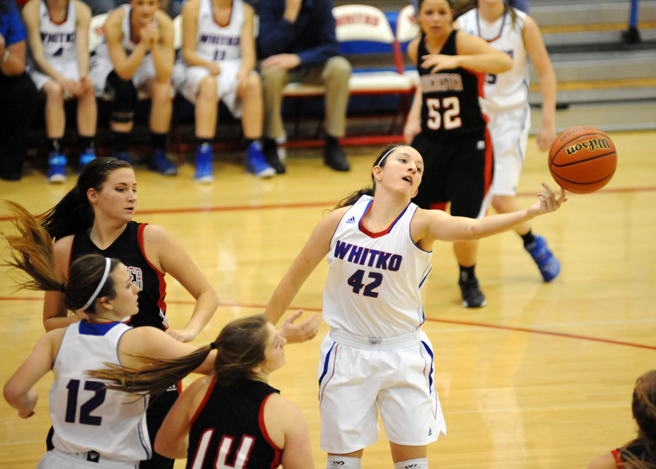 Whitko's Kennedy Krull gets a hand on a rebound Friday night in a 57-29 win against Manchester. (Photos by Mike Deak)