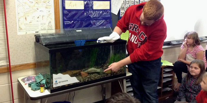 Center for Lakes & Streams Research Assistant, Josiah Hartman, presents an aquarium to Miss Jessie's classroom at North Webster Elementary School. (Photo provided)