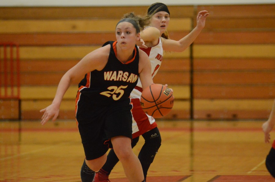 Madi Graham heads up the court for Warsaw Saturday night at Goshen. Graham helped the Tigers rally for a 37-33 NLC win.
