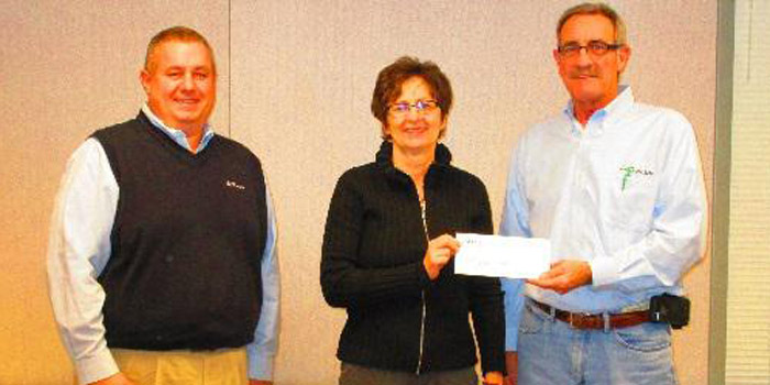 Pictured is Ag Plus CEO, Jeff Mize, and South Whitley Location Manager, Tom Warner, presenting Tonya Warner with a donation to go towards the South Whitley Area Emergency Food Bank