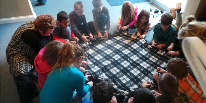 Students at Warsaw Christian Schools prepare knotted blankets for Heartline Pregnancy Center. (Photo provided)