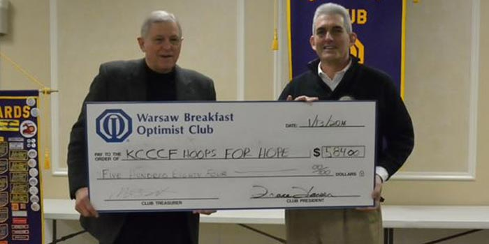 Pictured from left are Jim Kessler representing Hoops for Hope, and Jeff Owens, representing The Warsaw Breakfast Optimist Club. (Photo provided)
