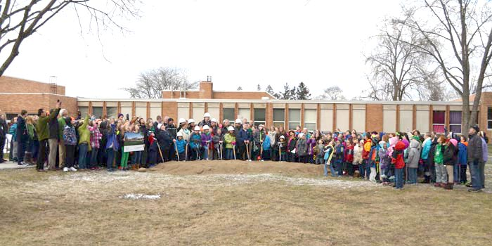 A crowd gathers for a ceremonial ground breaking for the Washington Elementary School construction project, slated to begin soon. (Photo by Amanda McFarland)