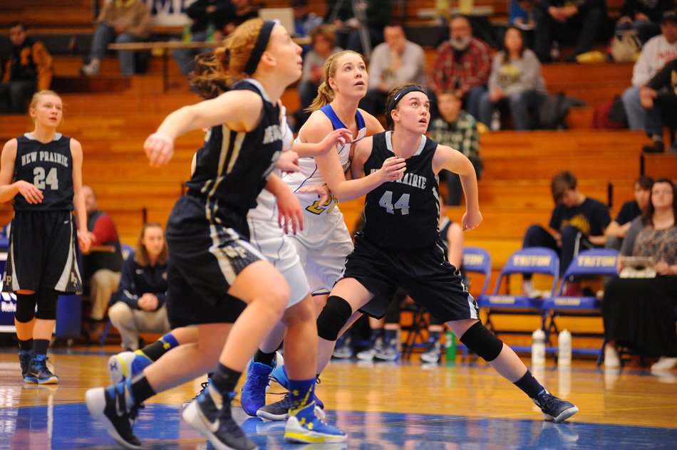 Brooklyn Beatty of Triton battles New Prairie defenders Brooke Prestin (30) and Emily Bradley (44) Tuesday night in the opening round of the Bi-County Tournament. (Photos by Mike Deak)