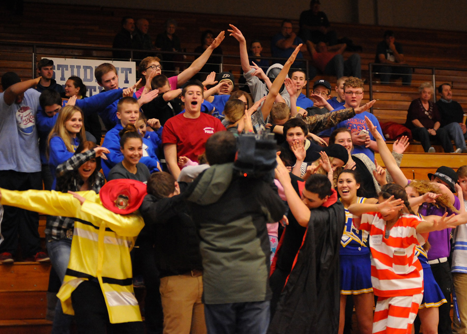 Triton's student section yucks it up for WNDU's Angelo Di Carlo during the game with New Prairie.