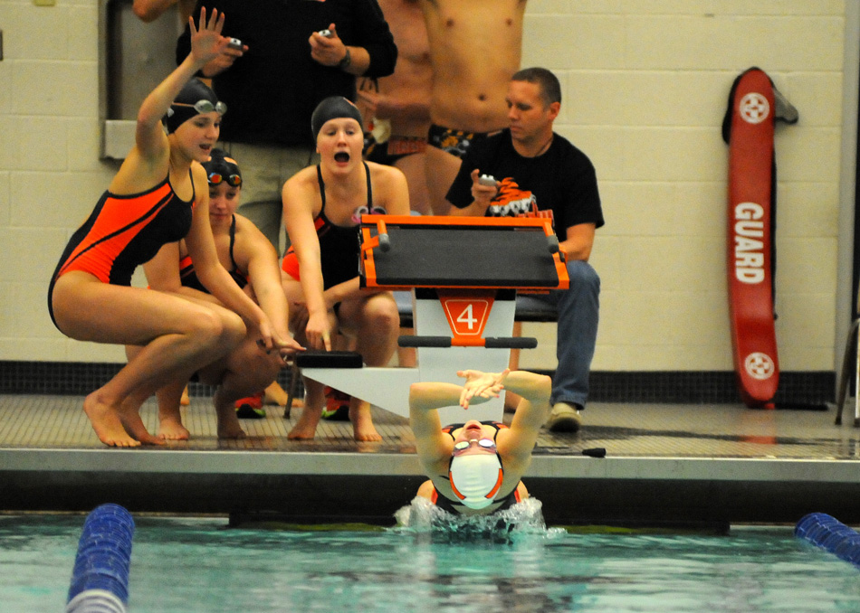 Warsaw's Lauren Kuhl breaks from the block at the start of the medley relay Wednesday. (Photos by Mike Deak)
