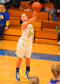 Triton senior Shayla May fires a three-point attempt in her final game at the Trojan Trench.