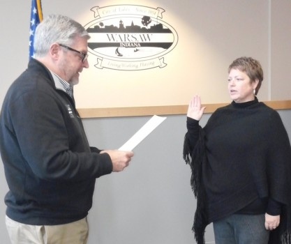 Michelle Boxell, right, takes the oath of office for a second term on the Warsaw Parks and Recreation Board from Mayor Joe Thallemer