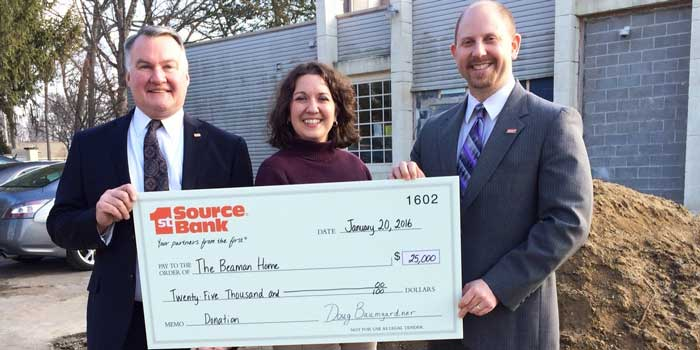 Photographed, left to right, 1st Source Regional President Bill Burton, Beaman Home Executive Director Tracie Hodson and 1st Source Warsaw City President Doug Baumgardner.