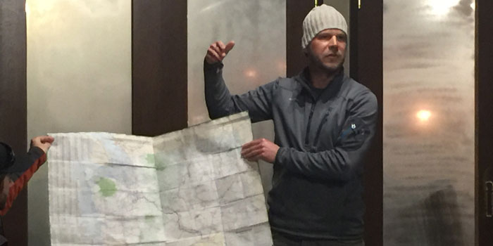 Brett Dickerson at the KCV meeting showing the group his travel route across America on a map (Photo by Michelle Reed)