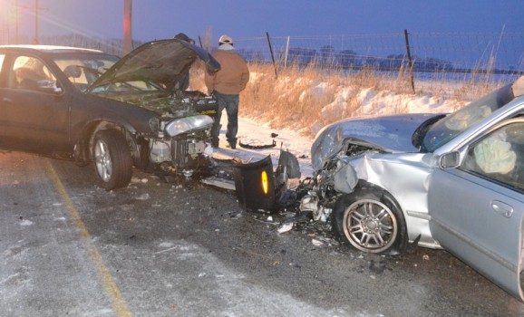 Two vehicles collided head-on on CR 700S. (Photo by Deb Patterson)