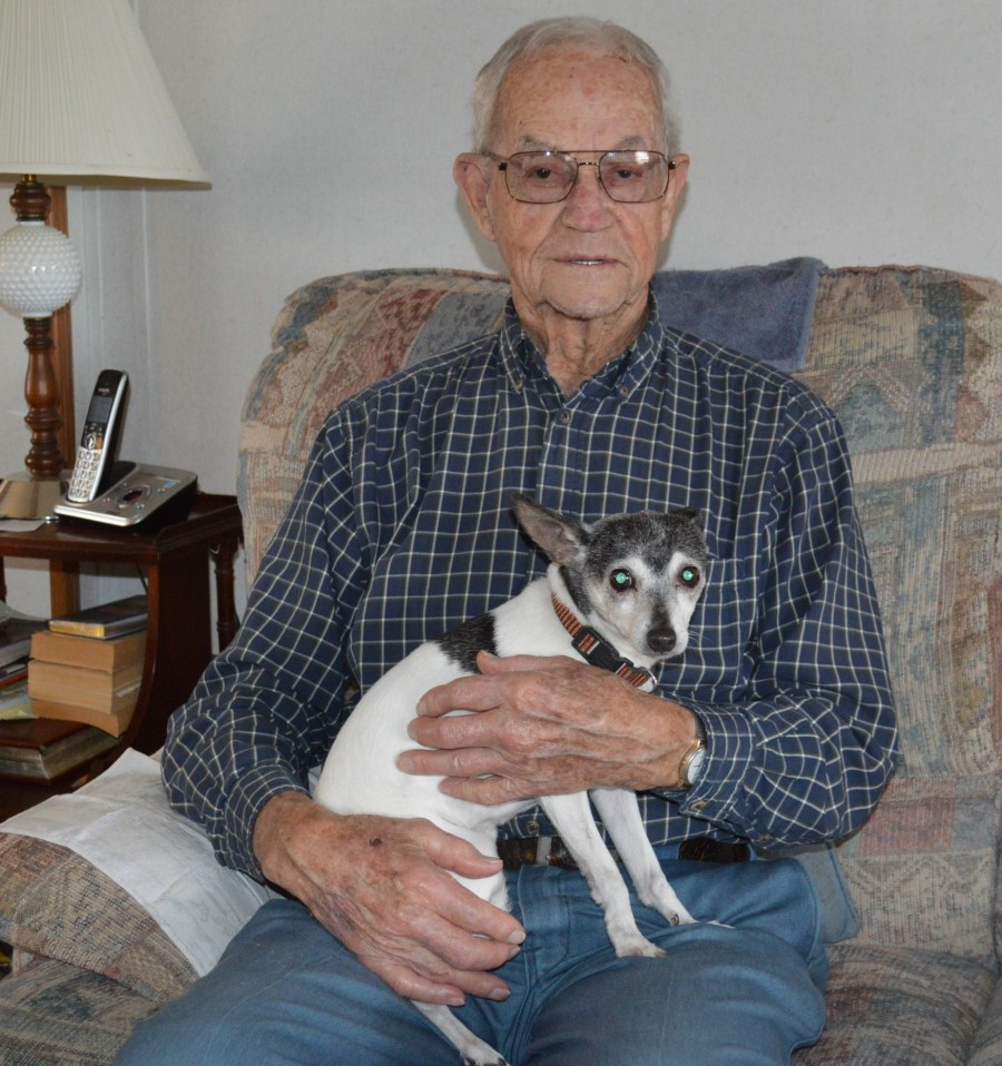 Don Shively is shown with Riley, his rat terrier dog, at his home on the west side of Claypool.