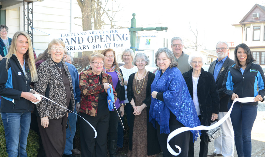 The grand opening of the Lakeland Art Center was held at 1 p.m. today with many friends, board members and artists on hand for the event. Shown in front, from left, are Jen Kerns, Kosciusko Chamber Main Street Coordinator; Darla McCammon, former board member; Melodie Koher, LAA president; Elizabeth Wamsley; Judy Marquart; Bev Garner, LAA secretary; Toni Walker, LAA treasurer; Warsaw Mayor Joe Thallemer; Willie Edmiston; Dave Taylor; and Alysa Lowe, marketing and communications, Kosciusko Chamber of Commerce. (Photos by Deb Patterson)