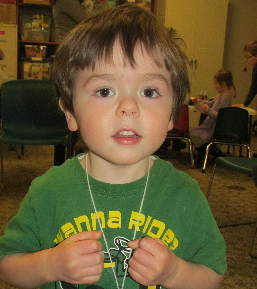 Marshall Wolf poses for a picture at Winter Preschool Story Time. The children celebrated Valentine's Day by making valentines and enjoying a treat of chocolate cake and a Hershey kiss.