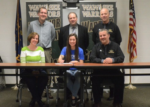 Pictured are, in front from left, Lori Lancaster, Sarah Lancaster and Scott Lancaster. In the back, WHS head coach Doug Heinisch, WHS principal Mike Schmidt and WHS AD Steve Wiktorowski. (Photo by Nick Goralczyk)