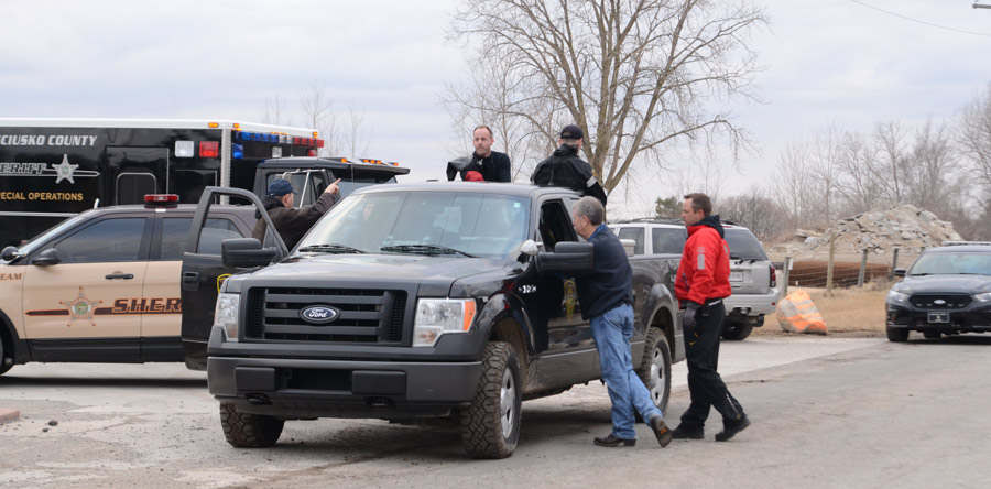Members of the Kosciusko County Dive Team load up on back of a conservation officers truck to travel down to the gravel pit pond to begin their dive search for a potential victim. (Photos by Deb Patterson)