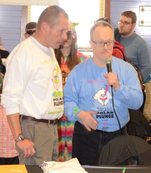 Buzz Liel, northeast coordinator, is shown with James Mornout, Special Olympian as he recites the the Olympian;s pledge.