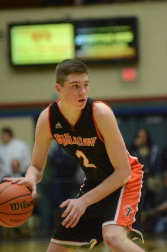 Kyle Mangas looks for room Friday night for Warsaw. The stellar guard had a game-high 16 points as the No. 5 Tigers topped Penn 52-31 in sectional semifinal play at Elkhart.