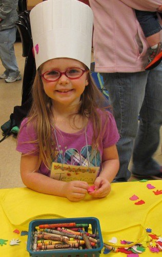 Four-year-old Jessica Targgart models the chef's hat she made during Preschool Story Time at the North Webster Community Public Library.