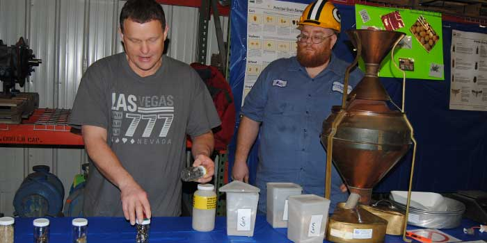 Two employees demonstrates a separator that rids soybeans of such debris as dead or live mice. Louis Dreyfus Commodities in Claypool had its seventh annual Global Safety Day Thursday, March 10.