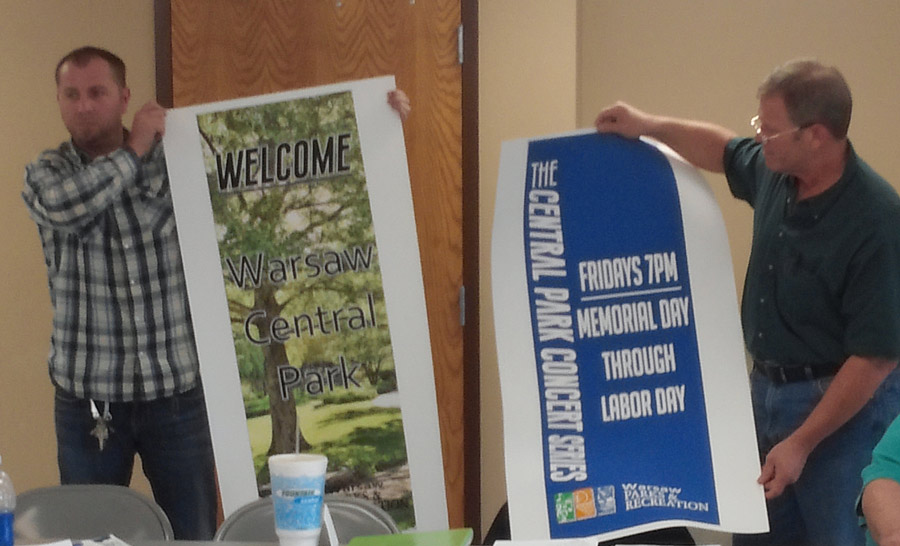 Shaun Gardner, maintenance, left and Larry Plummer, superintendent, hold up the two new banners chosen by the Warsaw Parks and Recreation Board.