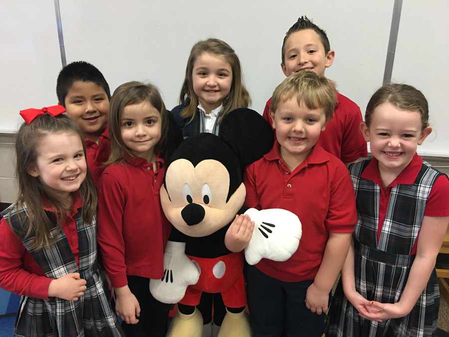 Lots of Disney dreaming at Sacred Heart School as pre-school and elementary school students seek to raise much needed funds for security upgrades by raffling a Walt Disney World Vacation for 4 with airfare, hotel accommodations and Disney dollars to spend at the parks. Shown, from left, are Elise Shively, Adiel Meyo, Emma-Claire Huffer, Adella-Mae Huffer, Charlie McSherry, Beckham Boylan, Mae Steinwedel. (Photo provided)