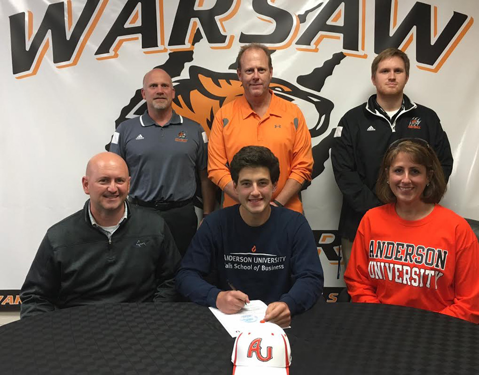 WCHS senior Joe Jackson will continue his football career at Anderson University. Seated with Joe are parents PICTURED (FRONT ROW L-R): Robert Jackson, Joe Jackson, Kathleen Jackson.  Back Row: Dave Anson (WCHS Athletic Director), Phil Jensen (WCHS Football Coach), Jake Cauhorn (WCHS Line and Special Teams Coach).