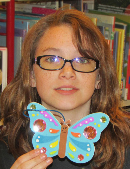 Wray displays her finished Jeweled Butterfly Craft she made during the Wawasee Community School Corporation's Spring Break.