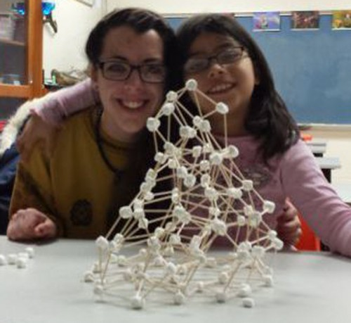 Grace College Student Rachel Brown and a first grade student building marshmallow tower during College Mentors of Kids program. (Photo provided)